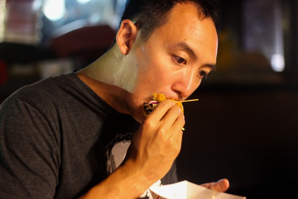 My brother noshing on a pork belly slider